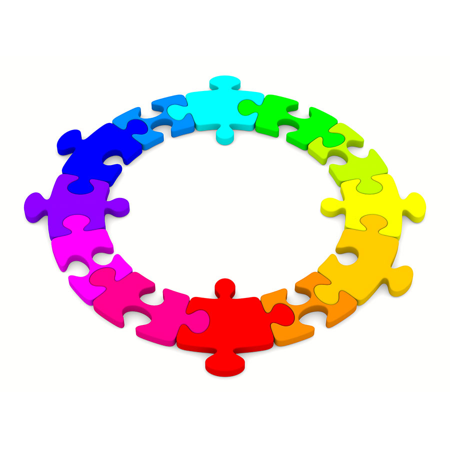 Flat circle of rainbow coloured puzzle pieces